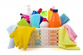 stock photo of disinfection  - colorful cleaning equipment in basket isolated on white background - JPG