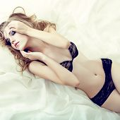 stock photo of orgasm  - Fashion portrait of a sensual girl in white bed - JPG