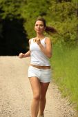 image of young girls  - Pretty young girl runner in the forest - JPG