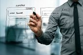 stock photo of process  - designer drawing website development wireframe with marker - JPG
