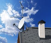 picture of antenna  - Satellite dish and TV antennas on the house roof with a beautiful blue sky - JPG
