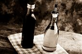 foto of vinegar  - olive oil and balsamic vinegar on a wooden table - JPG