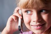 Little Blond Beautiful Girl With Mobile Phone