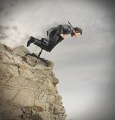 pic of interrupter  - Concept of crisis and financial disaster with businessman in a mountain - JPG