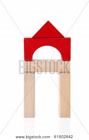 House Made Out Of Wooden Building Blocks Over White Background