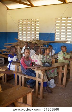 Kinazini, Kenya - July-12: Unidentified African Children Showing Their School For Tourists With Trad
