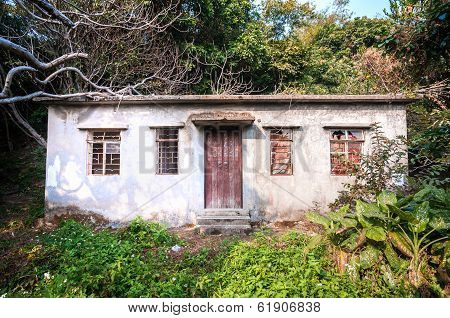 Abandoned house with overgrown trees, Hong Hong