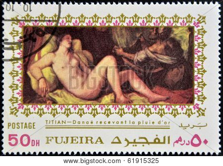 FUJEIRA - CIRCA 1985: Stamp printed in Fujeira shows Danae by Tintoretto circa 1985