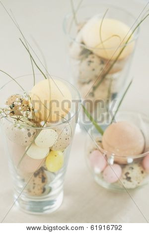 Easter eggs in glass background