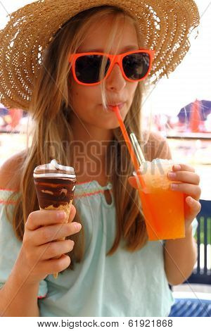 Beautiful Girl In Sunglasses, Ice, Slush On Beach