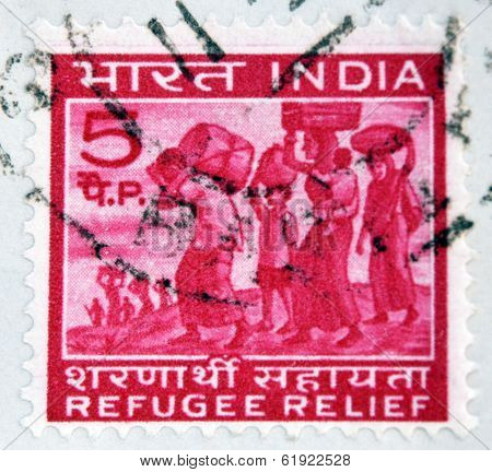 INDIA - CIRCA 1971: A stamp printed in India shows refugees from East Pakistan