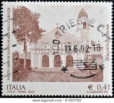ITALY - CIRCA 2002: A stamp printed in Italy shows Sanctuary of Santa Maria delle Grazie - Spezzano