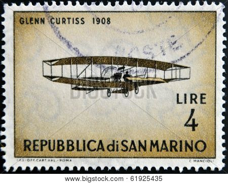 SAN MARINO - CIRCA 1962: A stamp printed in San Marino shows airplane by Glenn Curtiss 1908
