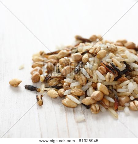 Pile Of Uncooked Multigrain Rice On White Wooden Background