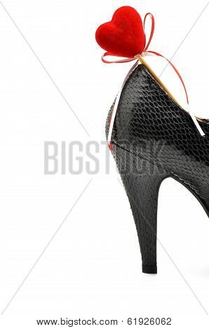 black shoe heel woman with red heart
