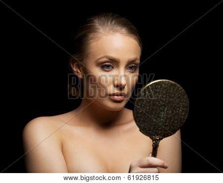 Young Woman Admiring Her Beautiful Skin In A Mirror
