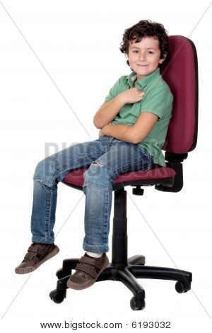 Adorable Little Boy Sitting On Big Chair