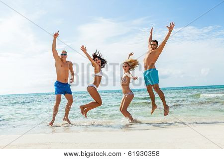 Young Happy Friends Havin Fun On The Beach