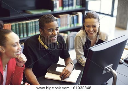Young People Enjoying Studying In Library