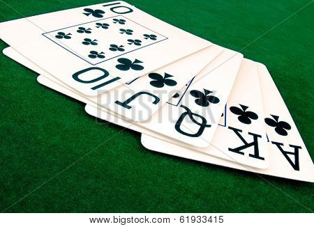 full house of playing cards on green felt