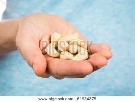 Hand Holding Cashew Nuts