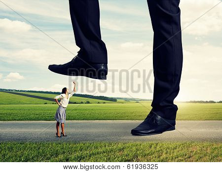 angry woman showing fist and shouting on the big boss at outdoor
