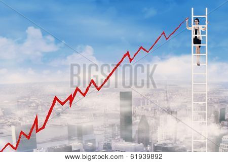 Businesswoman Drawing A Rising Chart