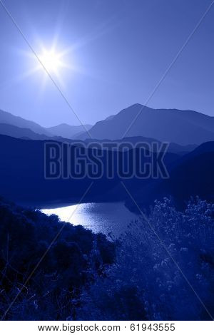 Silhouette Of Mountain Range Layered In Blue