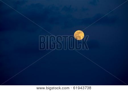 Dark blue sky with full moon and mistery clouds