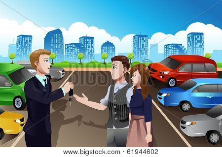 Car Salesman With Customers In The Dealership