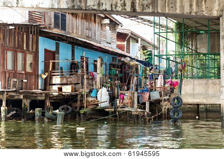 Shanty-town. on canal in Thailand