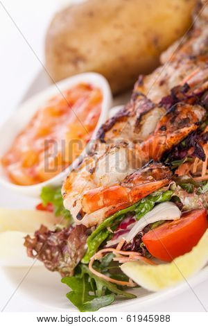 Grilled Prawns With Endive Salad And Jacket Potato
