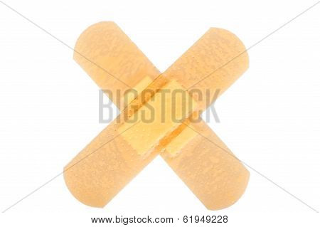 Two Band-aid In The Form Of A Cross Glued