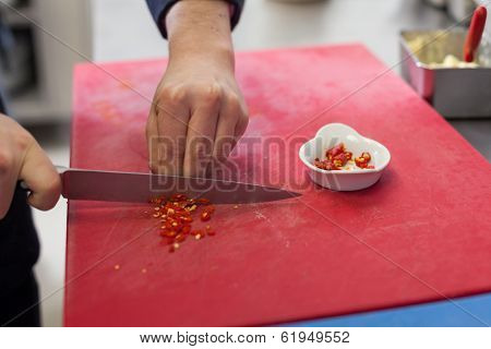 Chef Dicing Red Hot Chili Peppers