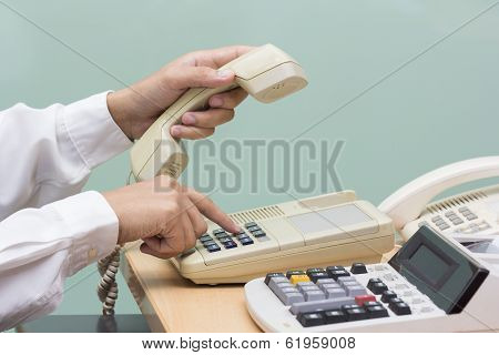 Businessman Using Telephone