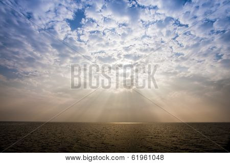 Sunbeam Through The Haze On The Sky Over The Sea