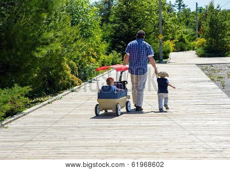Father And Sons On The Boardwalk.