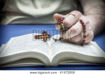 Christian Believer Praying To God With Rosary In Hand