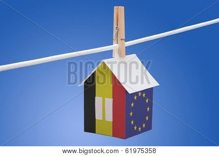 Belgian end EU flag on paper house