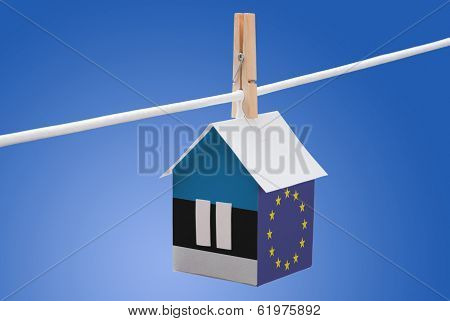 Estonia and EU flag on paper house