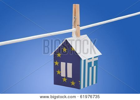 Greece, Greek and EU flag on paper house