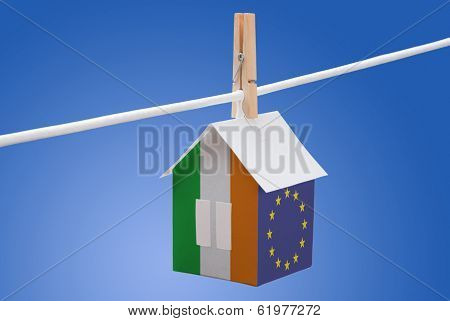 Ireland and EU flag on paper house