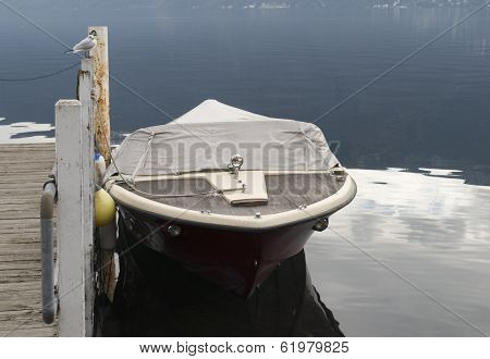 covered boat at dock