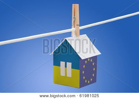 Ukraine, Ukrainian and EU flag on paper house