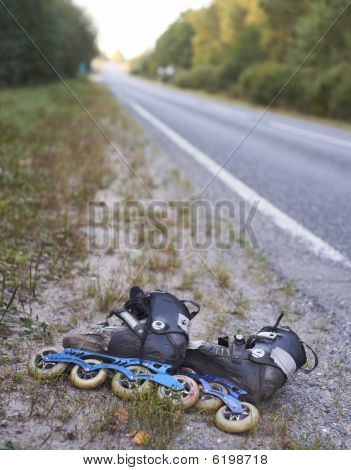 Rollerskates On Roadside - Environmet Friendly Transport
