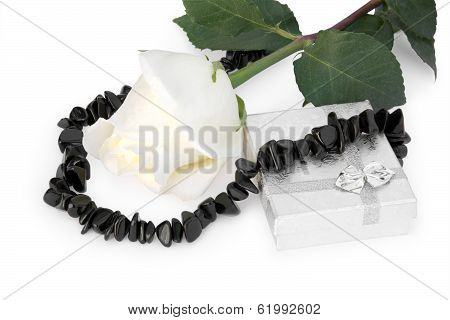 Necklace From Black Agate Round A White Rose, And A Gift