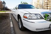 stock photo of limousine  - White wedding limousine on city street outdoors - JPG