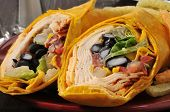stock photo of chipotle  - Closeup of a chicken wrap with chipotle and gouda cheese - JPG