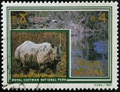 NEPAL - CIRCA 1991: A stamp printed in Nepal dedicated to royal chitwan national park shows rhino