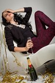 Seductive Brunette Holding A Glass Of Champagne
